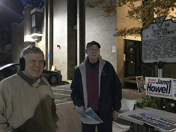 The first voter of the day arrives at Polling Place Reston Community Center-Lake Anne, 1609-A Washington Plaza, in the Lake Anne Plaza parking lot at 6:01 a.m.