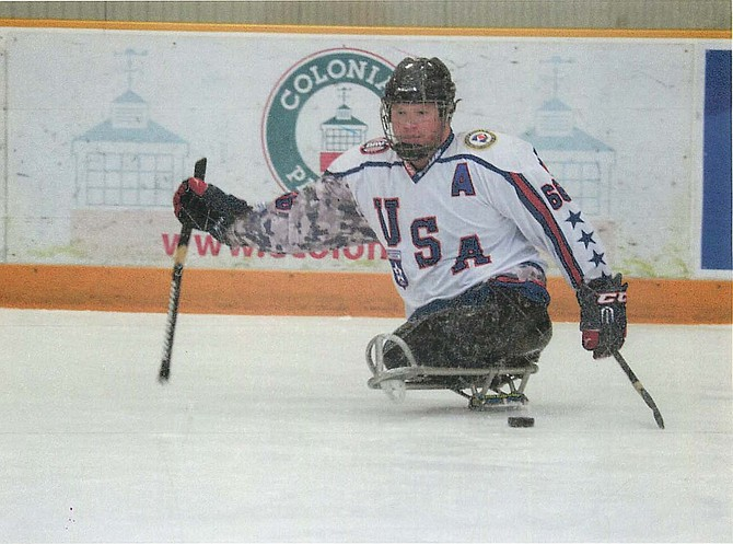 Rob Easley playing sled hockey with the USA Warriors sled hockey team.