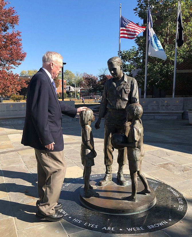 "USN Capt. Eugene ""Red"" McDaniel (ret.), pays his respects at the Captain Rocky Versace Plaza and Vietnam Veterans Memorial Nov. 6 in Del Ray. McDaniel spent six years as a POW at the ""Hanoi Hilton"" during the Vietnam War. A Veterans Day ceremony will be held Nov. 11 at 1 p.m. at the Rocky Versace Plaza."