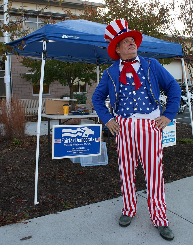 Wesley Dowling sported the Uncle Sam outfit at the Newington poll where voters in the Belvoir voting district cast their ballots. In recent years, this polling place was moved from the Kingstowne Library to this location, where many of the area school buses are parked.