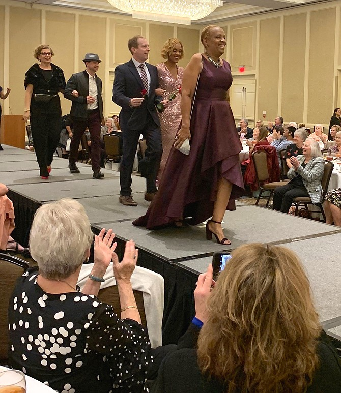 Wearing clothing provided by Lord & Taylor, models take to the runway at the annual Board of Lady Managers fashion show and luncheon Oct. 25 at the Mark Center Hilton. The organization raises funds to provide support to Inova Alexandria Hospital.