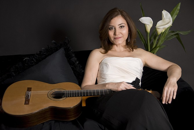 """Berta Rojas, special guest guitarist with Fairfax Symphony Orchestra in """"Nostalgic Nights"""" concert at the Harris Theatre, George Mason University."""