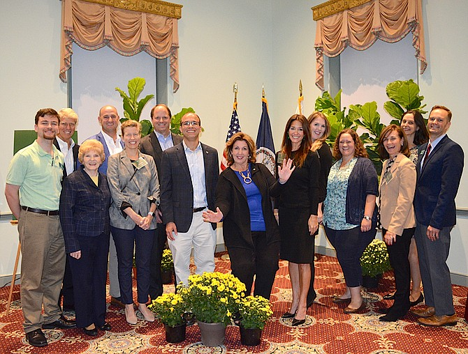 Members of City Council and the Alexandria Beautification Commission (left to right): Kevin Dunne, Richard Dorrier, Councilwoman Del Pepper, Geoff Montross, Emily Freeland, Donald Kent, Mayor Justin Wilson, Councilwoman Amy Jackson, Christina Mazurkevich, Mary Ensch, Denise Tennant, Monica Murphy, Kathryn Chiasson, Joseph Crowell.