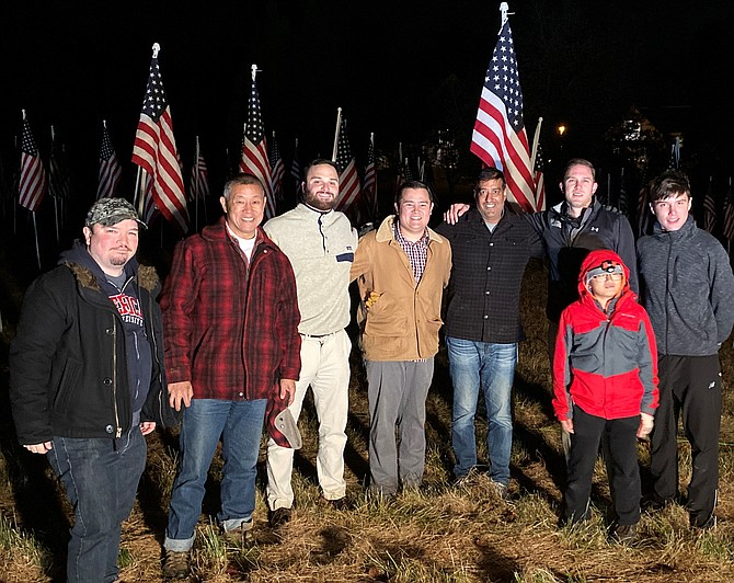 At dusk this past Friday, volunteers assembled in front of Saint Francis Church to construct the display which continued to stand through Veterans Day.