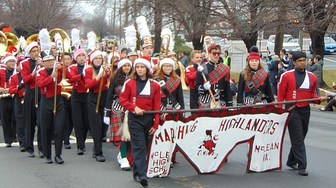 The McLean High School Highlanders Marching Band marches in the 2018 parade; the 2019 WinterFest Parade will be Dec. 1.