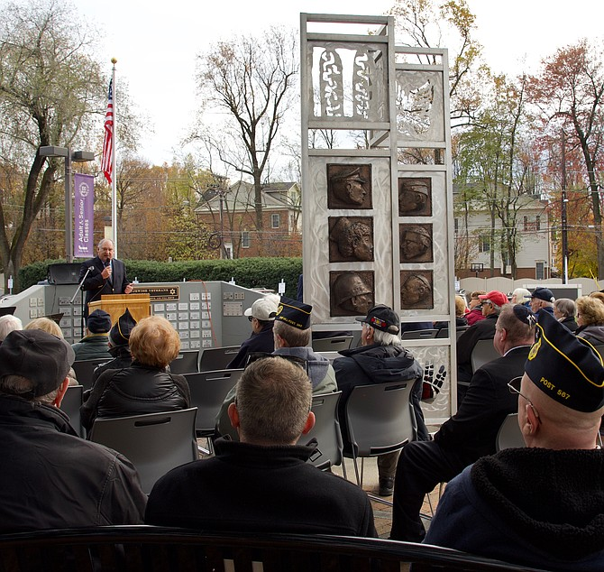 Marc Elrich, Montgomery County Executive, speaks at the Veterans Day program at the American Jewish Veterans Memorial on the grounds of the Bender Jewish Community Center in Rockville.