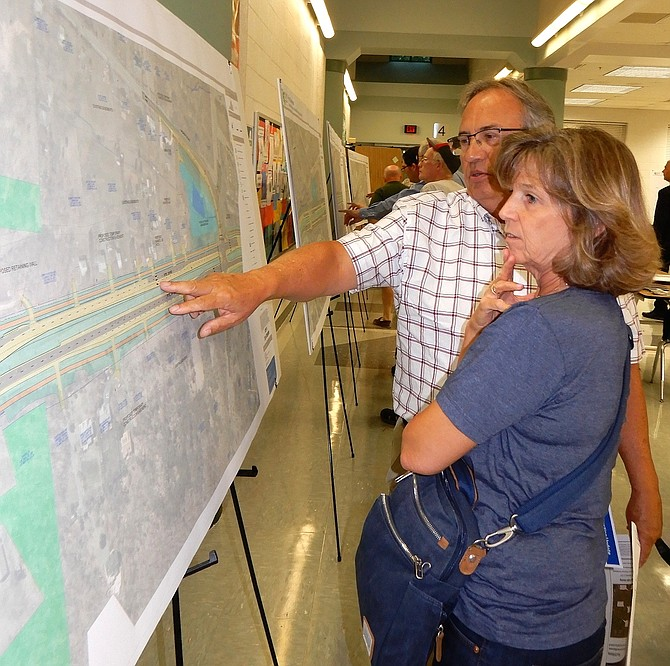 Centreville residents Teri and Marie Travi look at the project map, but worry that Route 28 will still be a bottleneck in Prince William County.