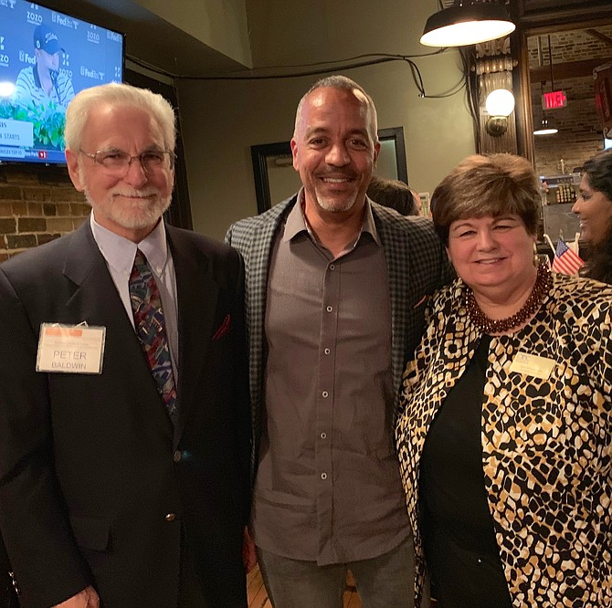 Shawn Perry, radio host of WOLB's Senior Connection (center), visits with Peter Baldwin and Gin Kinneman at the 12th annual Old Town Alexandria Connections reception Oct. 23 at Chadwicks Restaurant.