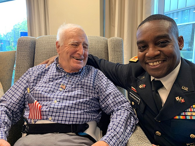 U.S. Navy veteran Don Rushford, left, shares a laugh with Chief Warrant Officer William Fearrington at the Veterans Day recognition program Nov. 8 at Silverado Alexandria Memory Care.