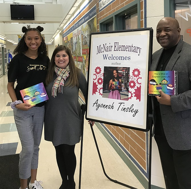 From left: Author/illustrator and Westfield High School student Ayonnah Tinsley celebrates with Fairfax County Public School principals Melissa Goddin, McNair Farm E.S and Dr. Anthony E. Copeland, Westfield, following the reading and discussion for her children's book, 'This is What an Engineer Looks Like' (2019) to students at McNair Farm Elementary School in Herndon.
