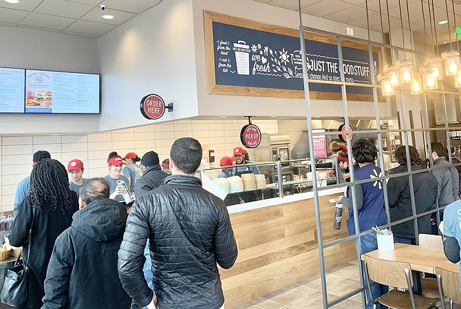 The first customers line up at the grand opening of B.GOOD in Tysons.