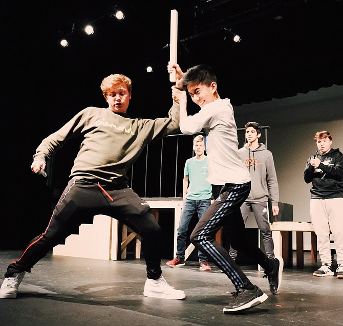 Chris Morgan (Tybalt) and Leland Hao (Benvolio). Standing behind are Nicolas Kristensen (Ensemble), Ethan Bhatia (Abraham), and Eli Roberts (Ensemble). Here Tybalt starts a brawl after Benvolio was only trying to keep the peace at the start of the show.