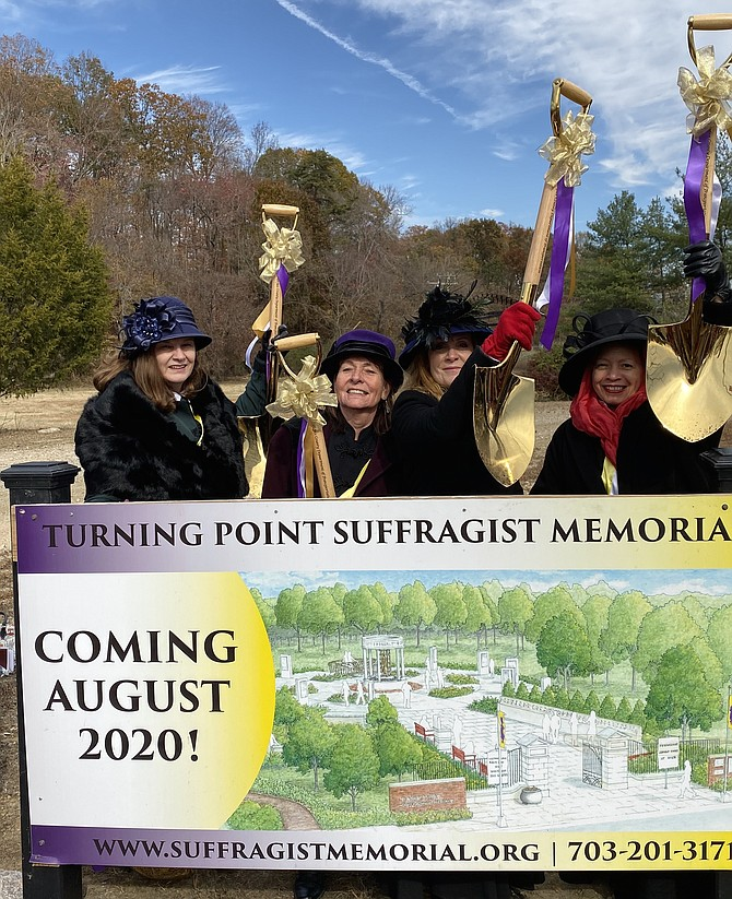 Dressed as American suffragists Alice Paul, Rose Winslow, Lucy Burns and Elizabeth Cady Stanton respectively, from left: Debbie Glaser of Woodbridge, Julianna Smith of  Woodbridge, Michelle McCall of Herndon and Quinn Jones of Arlington hold up shovels used at the Turning Point Suffragist Memorial Groundbreaking at Occoquan Regional Park, Lorton, Nov. 14, 2019.
