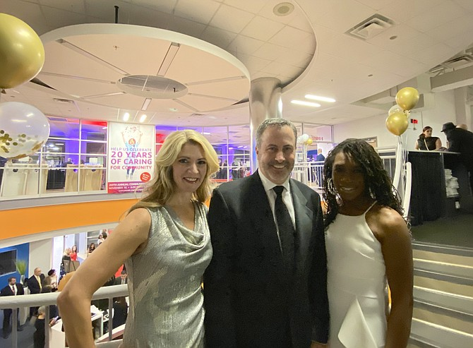 Restonians Taralyn Kohler, Executive Director CORE Foundation; Doug Bushée, Founder of CORE Foundation; and Traci Waller, pictured during the Opening Reception of the YMCA Fairfax County Reston 20th Annual Fundraising Gala.