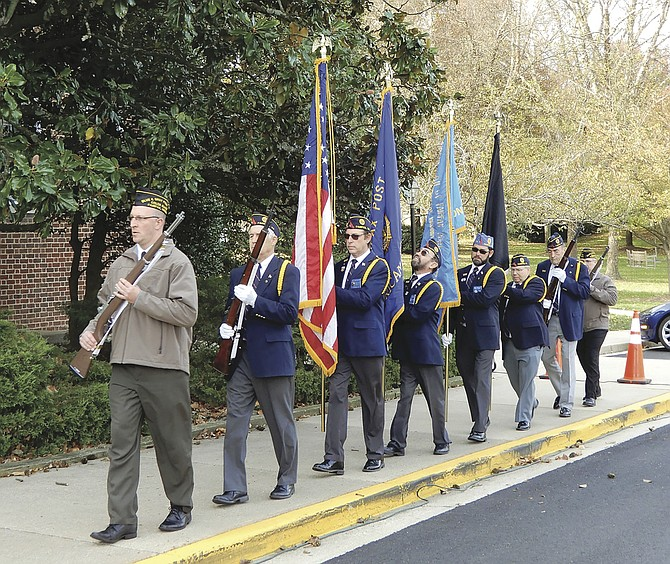 The American Legion Post 177 Color Guard begins Fairfax City's Veterans Day celebration.