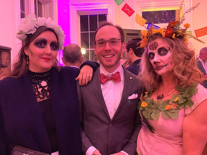 Brian Kelley, center, with Allison Nance and Lisa Schmaier celebrate at the Athenaeum's Day of the Dead Membership Appreciation Night Nov. 2 at the Athenaeum.