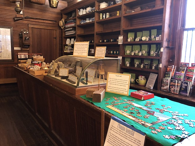 The original general store counter, topped with toys and mill-building tools.