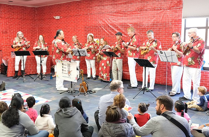 "The Northern Virginia Ukulele Society performs classic Sesame Street songs like ""Sunny Day"" and ""I Love Trash"" during a performance at the Reston Regional Library."