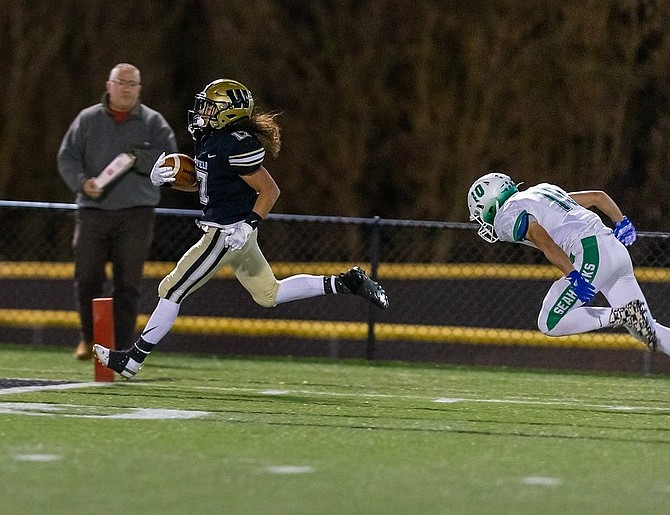 Avery Howard beats a South Lakes defender to the end zone.