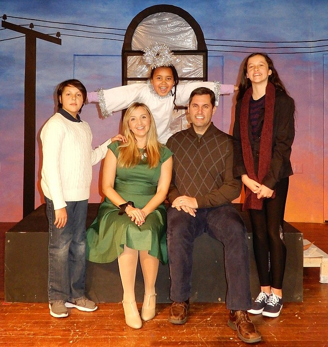 Cast members of City of Fairfax Theatre Co.'s upcoming play include Lilith Nees (the angel) and (front row, from left) Thomas Kennedy, Mindy Thomas, Gregory Kennedy and Mary Kennedy.