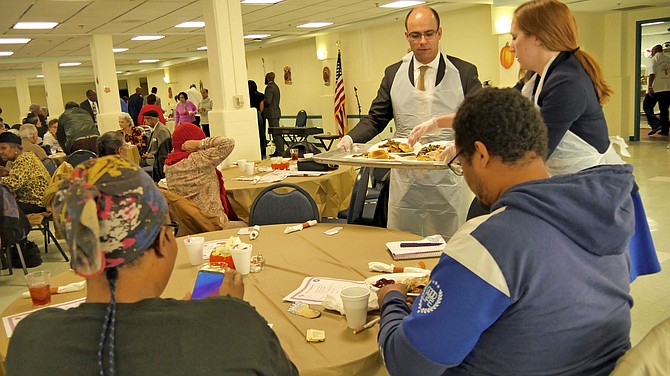 Mayor Justin Wilson and Vice Mayor Elizabeth Bennett-Parker serve Thanksgiving dinner to Alexandrians attending the community Thanksgiving event Saturday, Nov. 16.