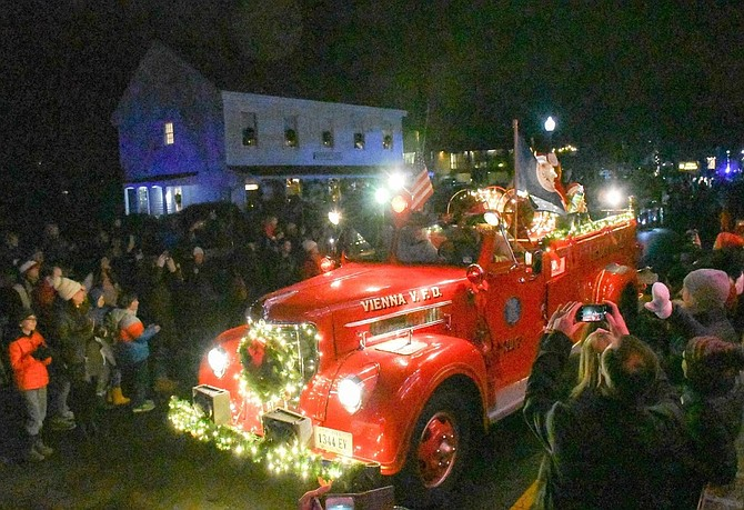 Santa waved to the crowd as he rode in on a 1940s VVFD firetruck.