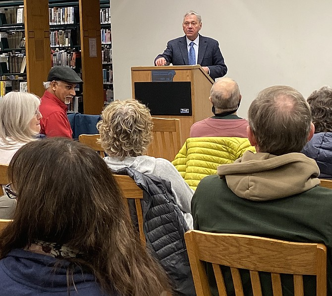 "Author Michael T. Klare answers questions during the book discussion for his newly released examination of climate change, ""All Hell Breaking Loose,"" held at Reston Regional Library Nov. 14."