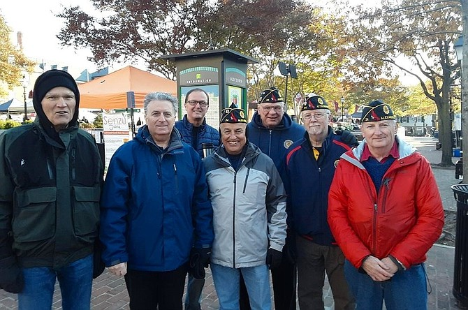 Members of American Legion Post 24 kick off the 2019 Salvation Army Bell Ringing season Nov. 16 at Market Square in Alexandria. Braving the blustery morning are (l-r); Sandy Sanor, Ozzie Abijaoude, Norman Sleeper, Al Soto, Joe Zelinka, Jim Glassman and Post 24 Commander Henry Dorton.