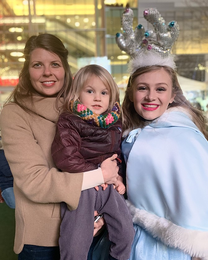 Megan and Aurora, 2, from Fairfax, with Cinderella.