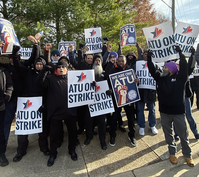 Amalgamated Transit Union Local 1764 Transdev workers picket in Herndon Friday morning, Dec. 6.