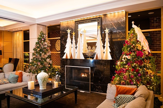 Erica Burns of Erica Burns Interiors designed a holiday tree that features bright colors, sparkling materials, and soft and textured finishes to engage the senses.