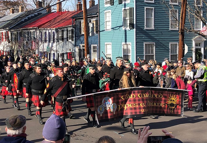 Clan MacLeod Pipes and Drums walks through the streets of Old Town during the Campagna Center's 49th annual Scottish Walk Parade Dec. 7.