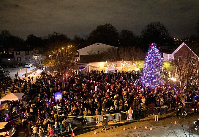 Hundreds gather for the lighting of a community Christmas tree and Menorah Dec. 8 at the Pat Miller Neighborhood Square in Del Ray.