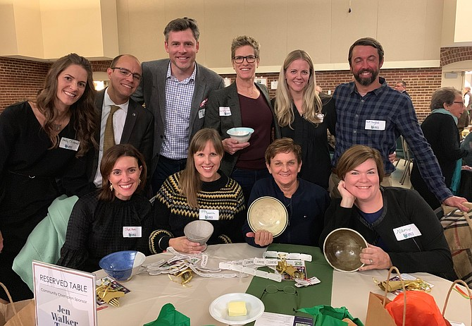 Mayor Justin Wilson, second from left in back, joins the Community Champion Sponsor Jen Walker Team for a photo at the 5th annual ALIVE! Empty Bowls Alexandria fundraiser Nov. 16 at the Durant Arts Center. The event raised $75,000 for the nonprofit organization's programs.