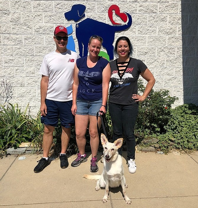 Vixen on adoption day — with foster caregivers Lloyd and Jackie Graybill and adopter Amanda Paz.