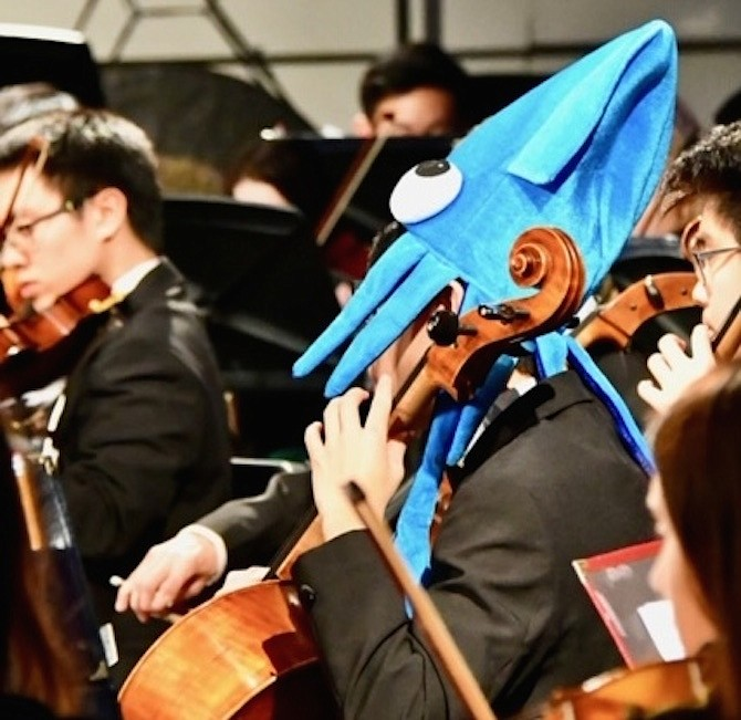 A Langley Orchestra student dressed as a sea creature in honor of their H2O performance.