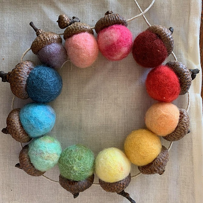 Artist Kathryn Coneway encourage students to create art using natural materials such as this wreath made of acorns and felt.