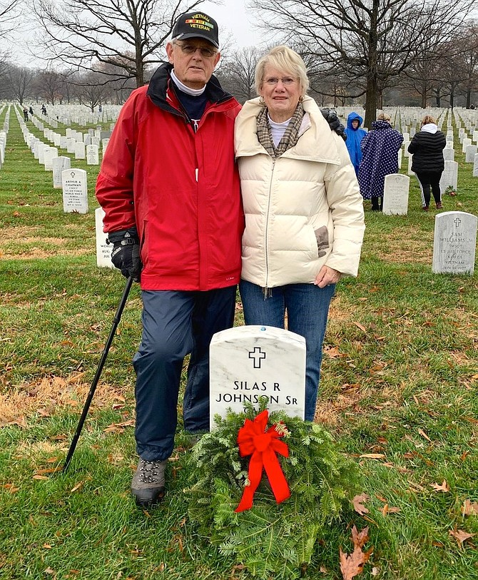 Jim Mogle, a U.S. Navy Vietnam veteran, and Nancy Mogle of Leesburg placed a wreath at Nancy's father's grave in Section 60 of Arlington National Cemetery during Wreaths Across America Dec. 14.  CAPT Silas R. Johnson Sr. was a pilot in the U.S. Navy for 32 years and served in WWII, Korea and Vietnam.