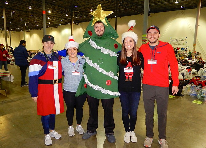 These employees of Tableau Software show their Christmas spirit. From left are Stephanie Weiss, Martha Shanfeld, Adam Gutekunst, Caroline Orr and Jason Warren.