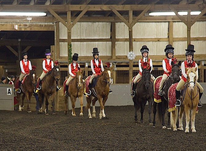 The Drill Team performing at the Potomac Horse Center holiday party.