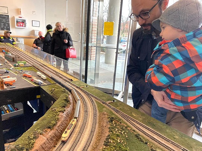 Luca Corso, 3, learns all about trains from his dad Phil, who likes the smaller N scale models.