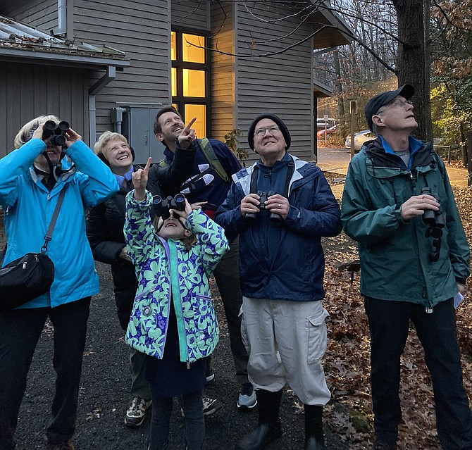 From left: Outside of Nature House in Reston, bird counters Joanne Bower of Reston; Barbara Ehst, Avery Ehst, 7, and Mike Ehst of Arlington; Jay Hadlock of Herndon; and David Bower look toward the treetops searching to sight the group's first feathered friend to tally in the 2020 Reston Association Winter Bird Count held Saturday, Jan. 4.