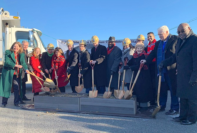 Virginia Gov. Ralph Northam (D), center, is joined by current and former city officials and staff at the Dec. 19 groundbreaking for the future Potomac Yard Metro Station, scheduled to open in 2022.