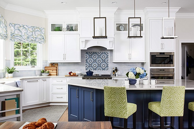 Designer Allie Mann Classic added blue island cabinetry, and accenting blue tiles as the backsplash above the range, in this Arlington, Virginia kitchen.