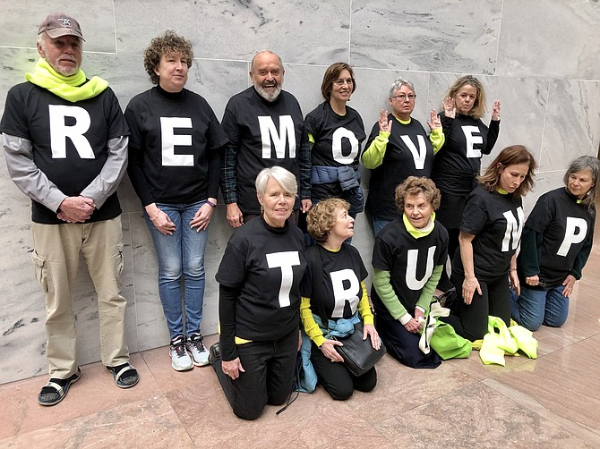 Eleven members of Herndon-Reston Indivisible join other resisters in peaceful protest at the U.S. Senate to press for trial and removal of President Trump. Here they spell out the message.