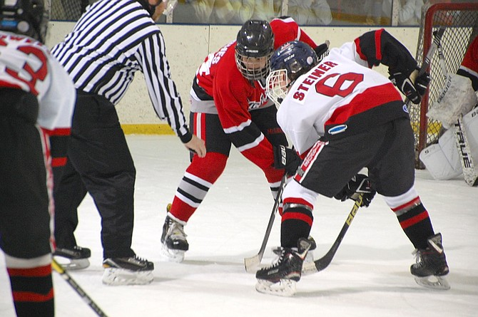Madison forwards Leo Steiner and Ben Cowell face off against the McLean Highlanders. Steiner had one goal and one assist; however, Madison would fall to McLean 3-9.