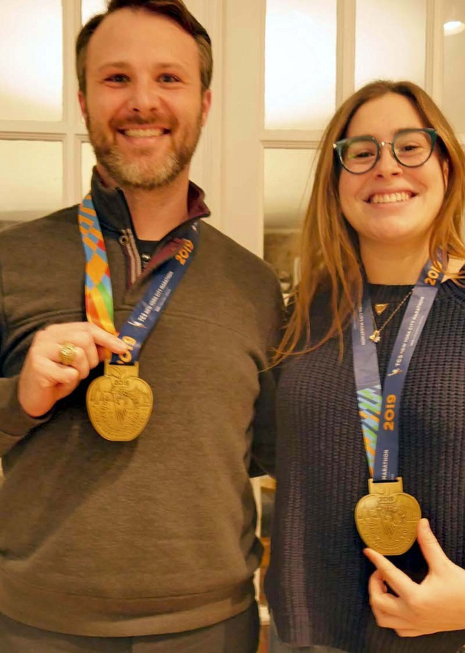 Desy and Babb display their NYC marathon medals.