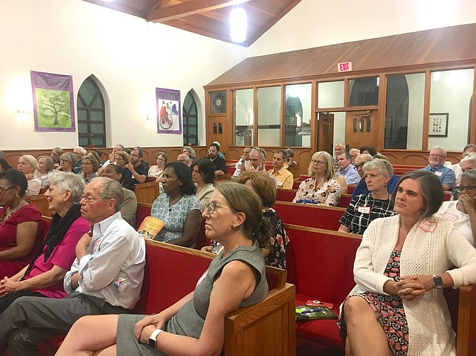 The crowd at the church included many Arlington residents who are following a series of lectures and events given by Challenging Racism.