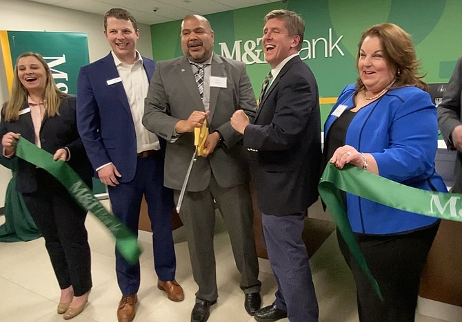 """When the first pair of shears didn't cut it at the ceremonial ribbon-cutting for the Grand Opening of M&T Bank, Metro Center Drive, Reston, """"take 2"""" brings laughter from (left to right) Tara Abraham, Assistant Vice President and Retail Support Specialist M&T Bank; Chris Nichols, Business Banking Market Manager in Greater Washington M&T Bank; Dee Kakar, Vice President Business Banking Team Leader in Northern Virginia M&T Bank; Supervisor Walter Alcorn (D-Hunter Mill)."""