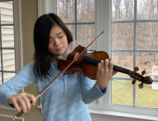 """Kayleigh Kim, 15, of Oak Hill, always dreamed of participating in the prestigious Menuhin Competition, dubbed the """"Olympics of the Violin."""" Selected as a finalist, she is dedicated to practicing for the event."""